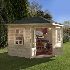 Art studio shed.   http://www.worldstores.co.uk/p/Forest_10ft_x_10ft_%283m_x_3m%29_Wenlock_28mm_Log_Cabin.htm