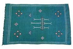 How gorgeous is this vintage teal rug?!