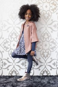 Great curly hair on a child.  Love her simple + chic outfit too!