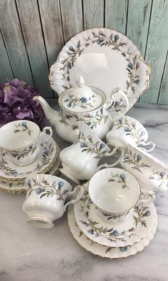 Brigadoon by Royal Albert Tea Set for Four Excellent Vintage with Teapot 15 Pieces Free Shipping in USA All pieces vintage back stamped made in England all pieces in excellent condition. They look gorgeous displayed on a shelf but I so hope you use them. Yeah for tea parties! This 15