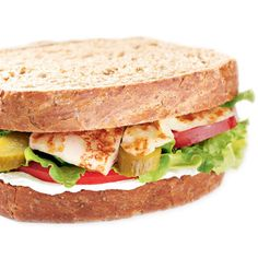 HALUMI - A Mediterranean specialty! Grilled halumi cheese, cream cheese, sliced tomatoes, sour pickles, and lettuce on your choice of freshly baked Aroma bread.