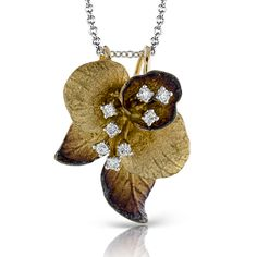 The realistic leaves of this 18K yellow and brown gold pendant are given glisten with .13ctw of white diamonds. Fashion | Organic Allure Collection | Simon G DP236-Y