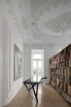 A lavish XIX Century Lisbon Apartment is transformed into a modern day living space by AVA Architects. The team of architects has taken the historic elements of the apartment intact, importing them into a modern living space. Lisbon Apartment, Parisian Apartment, European Apartment, Home Library Design, House Design, Dream Library, Loft Design, Library Art, Design Desk