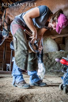 A farrier installs horse shoes onto a clydesdale quarter horse mix. Equine photography by Ken Van Pelt of Ken Van Pelt Fine Art & Photography, providing all forms of equine photography such as riders, english, western, tack and more. Other services such as family, pet & event photography available. Thanks for viewing my work to see more please visit www.kenvanpelt.com