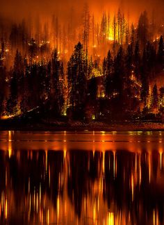 Courtney Fire Closeup (fire on the water, smoke in the sky) (by Darvin Atkeson)