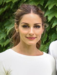 Olivia's wedding makeup was as simple and chic as her outfit. Her focus was perfectly defined brows, feline lashes and rose pink lips. This classic understated makeup will cease to date in the photos.