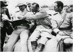 Errol Flynn, director Michael Curtiz and David Niven during filming of The Charge of the Light Brigade, 1936.