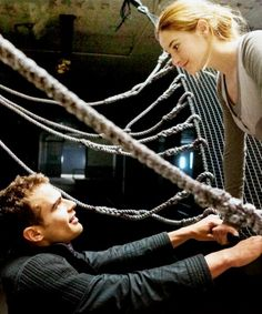 "~ Divergent ~ Four ~ Tris ~ The Stiff jumped first. Tris's face she's like ""Wow he is hot!""OMG four was right tris does look radiant here"