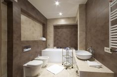 Brown And Tan Bathroom With Single White Sink