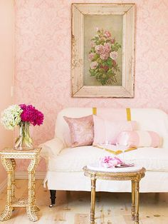 Here, a vintage painting of blossoms sets the scene for a slipcovered settee and European cocktail table:http://www.bhg.com/decorating/color/schemes/what-color-goes-with-pink/?socsrc=bhgpin051514powderpinkandrose&page=4