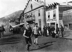Men participating in a foot race, Dawson City, YT, c. 1900.