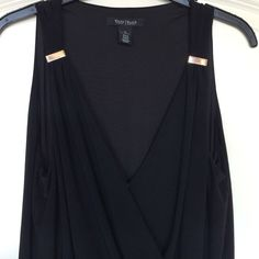 White House Black Market mini dress romper super cute romper. very flowing material. neck line has 2 small snaps to keep from showing too much. shorts underneath are covered by material so it looks like you are wearing a short skirt. slim elastic waste band goes all the way around.  side is attached by a small gold loop that matches gold clamps on shoulder straps. also has thin lining. 95poly 5spandex. machine wash. White House Black Market Dresses Mini