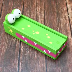 Turn a plain wood box into a fun alligator pencil box.  Great for organizing and storing supplies!