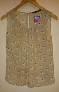 Atmosphere dog top, £1 - Cancer Research UK