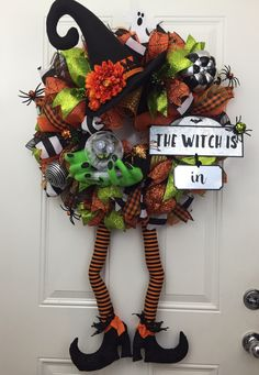 A personal favorite from my Etsy shop https://www.etsy.com/listing/465689066/halloween-deco-mesh-wreath-wicked-wich