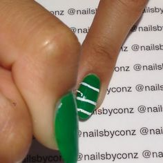 "Video..Football-Themed nails recreated @banicured_ nails  #lookbanicured  Music- NFL PrimeTime Song -----products used-----  Beauty Treat Nail ""Lucky Charm""  #sinfulcolors ""Nirvana""  white acrylic paint  Dance 24 from @stylishnailartshop #Padgram"