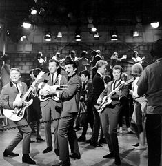 Don Wilson Mel Taylor Nokie Edwards and Bob Bogle of the rock and roll band 'The Ventures' perform onstage on the TV show American Bandstand with. Don Wilson, The Ventures, American Bandstand, Rock And Roll Bands, Ghost Hunters, The Rock, Dancer, Tv Shows, Bob