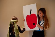 Pin the Catterpillar on the apple. - A Very Hungry Caterpillar Birthday Party | Lavender's Blue Designs