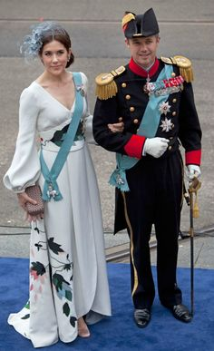 interesting dress like a kimono from Charlotte Lynggaard the Princess Mary of Denmark Princess Victoria of Sweden (in a dress by  Escada and Philip Treacy hat) with her ​​husband.