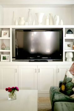 Inexpensive Built In Wall Units | Modern basement featuring built-in wall unit with lighting and ...