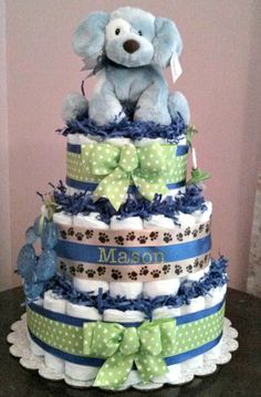 Throwing together a baby shower? Look no further, here at Baby Cake Designs we have many different styles of diaper cakes available along with many other creative designs like wreaths and centerpieces for your upcoming event. Puppy Diapers, Baby Shower Diapers, Baby Boy Shower, Baby Shower Gifts, Baby Gifts, Puppy Gifts, Dog Gifts, Baby Shower Parties, Baby Shower Themes