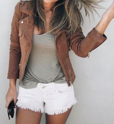 Brown suede moto jacket, gray tee, white distressed jean shorts
