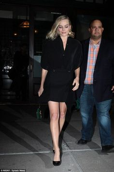 Flying solo! Radiant Margot Robbie shows off her pins in a little black dress amid reports husband Tom Ackerley wants her to 'scale back' on work commitments to start a family
