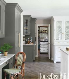 This multipurposeNew Jersey kitchen designed by Caitlin Wilson all comes together thanks to its consistent hue, Benjamin Moore's Natura in Silhouette. - HouseBeautiful.com