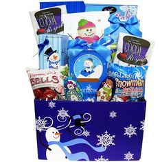 Our sweetest snowman is a quite the charmer surrounded by snowflakes that decorate this adorable care package gift box. #christmas #holidays #gift #basket www.artofappreciation.com
