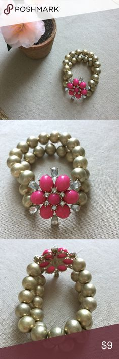 Pink Flower Bracelet This is a brand new pink flower bracelet with crystals and gold beads. It is stretchy and sure to stand out on your wrist! Prices $10 and below are firm. Bundle 2+ of my items and save 10%! I do not trade or hold items. Jewelry Bracelets