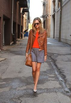 Love the combo! Brown leather jacket with striped skirt!