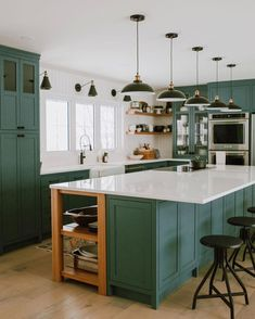 Green kitchen + glass front cabinets + green cabinets + vintage runner + black and gold wall sconces + black and gold pendant lighting + green island + white countertops + open corner shelving + backless swivel counter stools Pine Kitchen Cabinets, Green Cabinets, Kitchen Cabinet Colors, Shaker Cabinets, White Cabinets, Home Interior, Kitchen Interior, Kitchen Design, Green Kitchen Island