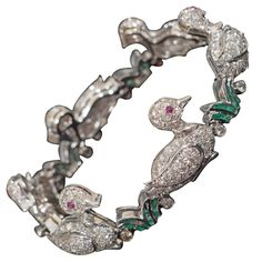 Row of Ducklings Platinum Bracelet Accented with Diamonds, Rubies and Emeralds