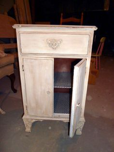 Antique night stand.  DIY chalk paint with BM antique white.  Hand distressed.  Annie sloan wax tinted with paint tinter.  Shelf liner on the inside.  So cute for an old piece.