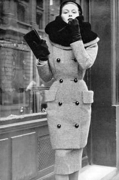Model in black and white tweed coat and skirt with large otter fur-lined collar and two large pockets by Jacques Griffe, photo by Pottier, 1950