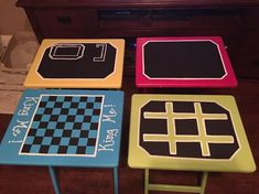repurposed set of TV trays with bright paints and chalkboard paint. Hangman, checkers, tic tac toe, and a chalkboard for their own creations.