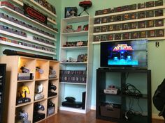 Retro Game Room Version 2 I needed to patch the walls and paint, so I thought I might as well change it all up. 23 different consoles and handhelds, about 450 old games. Framemeister xrgb-mini...