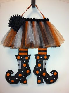 Inspiration for a DIY- Witches Legs Burlap Door Hanger. $30.00, via Etsy.