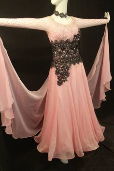 Beautiful pink stoned ballroom dress for sale. Full skirt, covered in stones, black lace accents around waist with lots of stones. Long sleeves with attached floats. Necklace included. Size adult medium. Please contact me for measurements or with additional questions. $1800 USD or best offer.