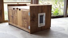 Appealing Cat Litter Box Furniture Inside Modern Side Cabinet Made Of Woods And Completed With Small Doors To Open The Box