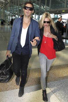 July 27 2011  Following their honeymoon - which saw the couple sail the coasts of Portofino, Cannes and Corsica - they travelled to Australia, where The Kills played the Splendour in the Grass festival. Arriving at Sydney Airport, she wore skinny grey jeans with a black blazer, red top and ankle boots.