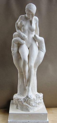 Erick Aubry sculpture of large hand holding nude female figure