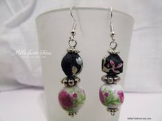 Excited to share the latest addition to my #etsy shop: Handmade ceramic and fabrics beads earrings floral painted white black pink http://etsy.me/2Cwudhg