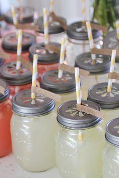 lemonade, yellow striped straws, daisy lids