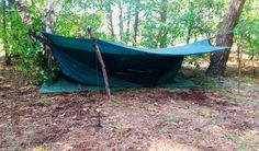 Using the Safari Deluxe Asym Zip from Hennesy hammocks as a two-person bivi bag. It kept us dry during a heavy summer rain and thunder storm.