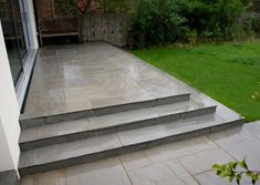 Kandla Grey Patio Pack Tumbled, Calibrated Sandstone paving slabs often the first choice for natural stone paving in your garden. Indian Sandstone provides limitless possibilities for your garden paving stone design. Guaranteed high quality and affordable Patio Steps, Garden Steps, Indian Sandstone Paving Slabs, Grey Paving, Paving Edging, Porch Kits, Raised Patio, Building A Porch, House With Porch
