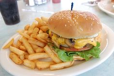 mushroom cheeseburger with fries