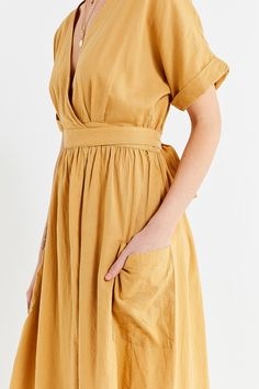 Shop UO Gabrielle Linen Midi Wrap Dress at Urban Outfitters today. We carry all the latest styles, colours and brands for you to choose from right here.