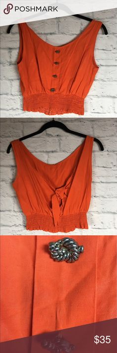 "Guide Fashion Vintage Crop Top, Burnt Orange . Guide Fashion Vintage Crop Top, Burnt Orange. Measurements are as follows: Armpit-to-armpit: 15"", elastic band around belly: 11.5"", length: 15.5"". Awesome pretzel-shaped bronze buttons!! This crop top is perfect for summer or a night out dancing! Treat yourself.  :) Guide Fashion Tops Crop Tops"