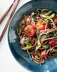 Soba Noodles with Miso-Roasted Tomatoes ------------- Roasting cherry tomatoes in a mix of miso, ginger, sesame, lime juice and honey creates a tangy, bright sauce for soba noodles; try adding shrimp for an even more substantial dish.